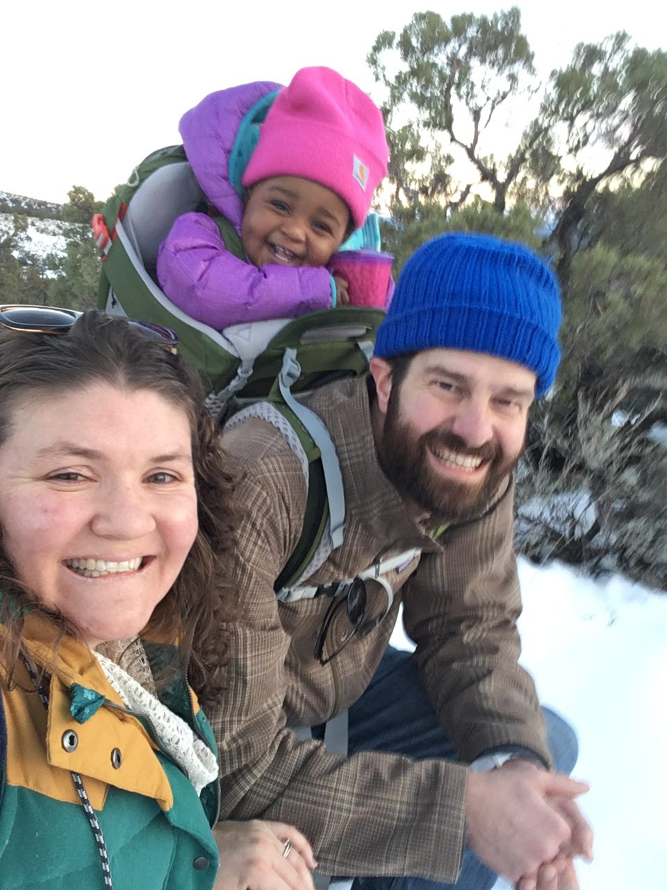 family hike in the snow